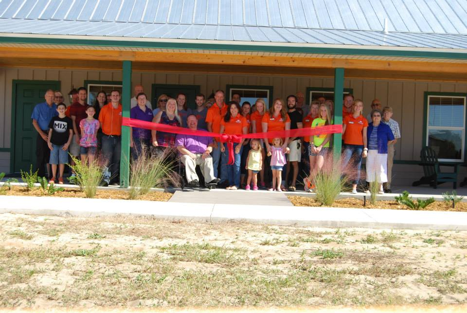 Ribbon-cutting ceremony for James & John Cabin