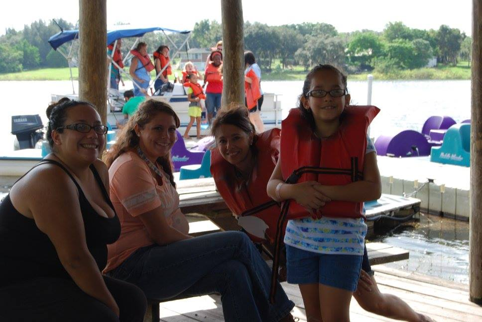 Mothers and daughters spend time together at the boats