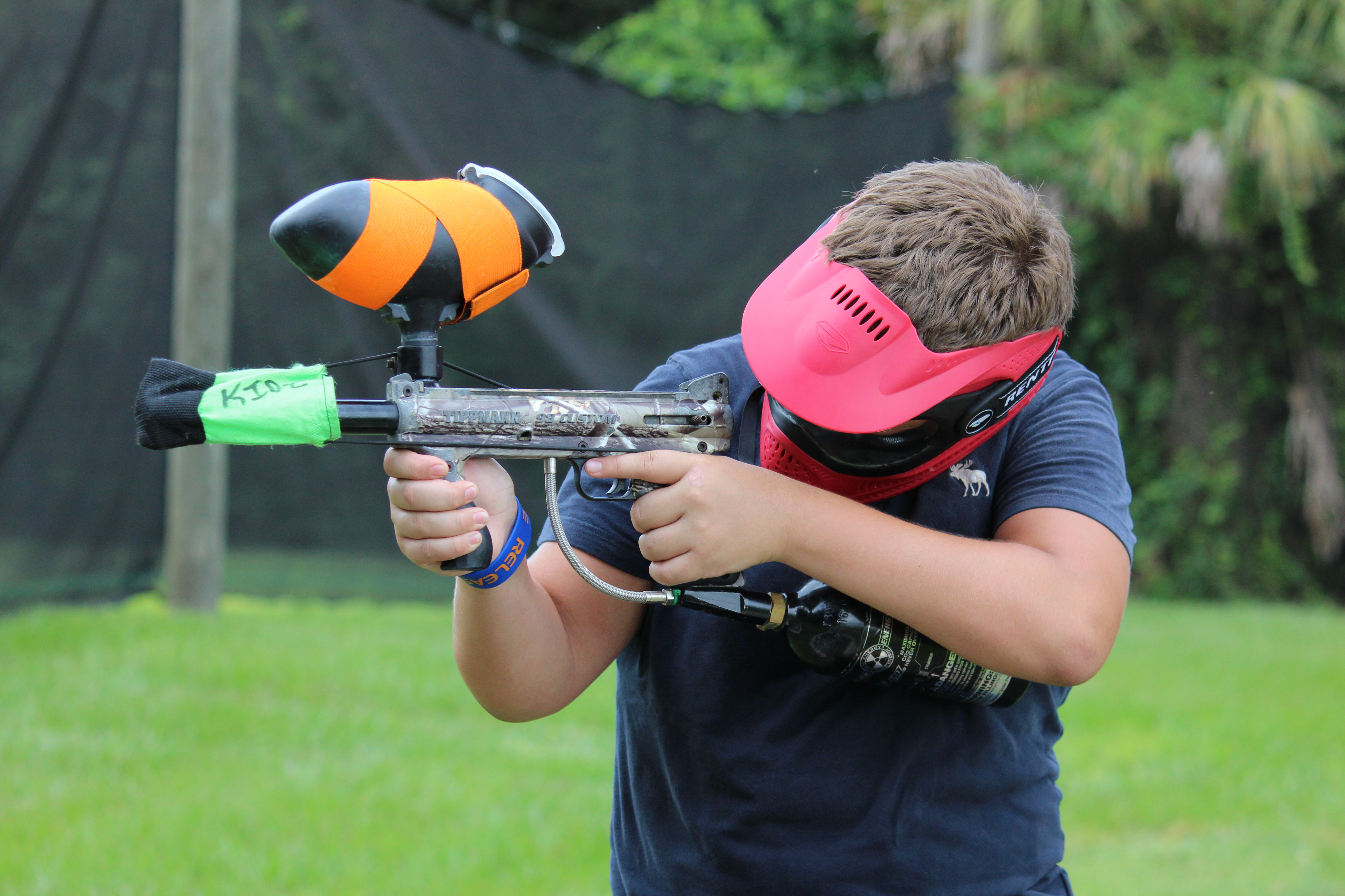 Camper takes aim with paintball gun