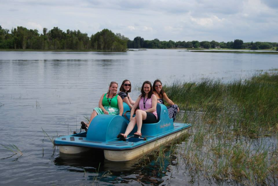 Four women on smiling on paddleboat